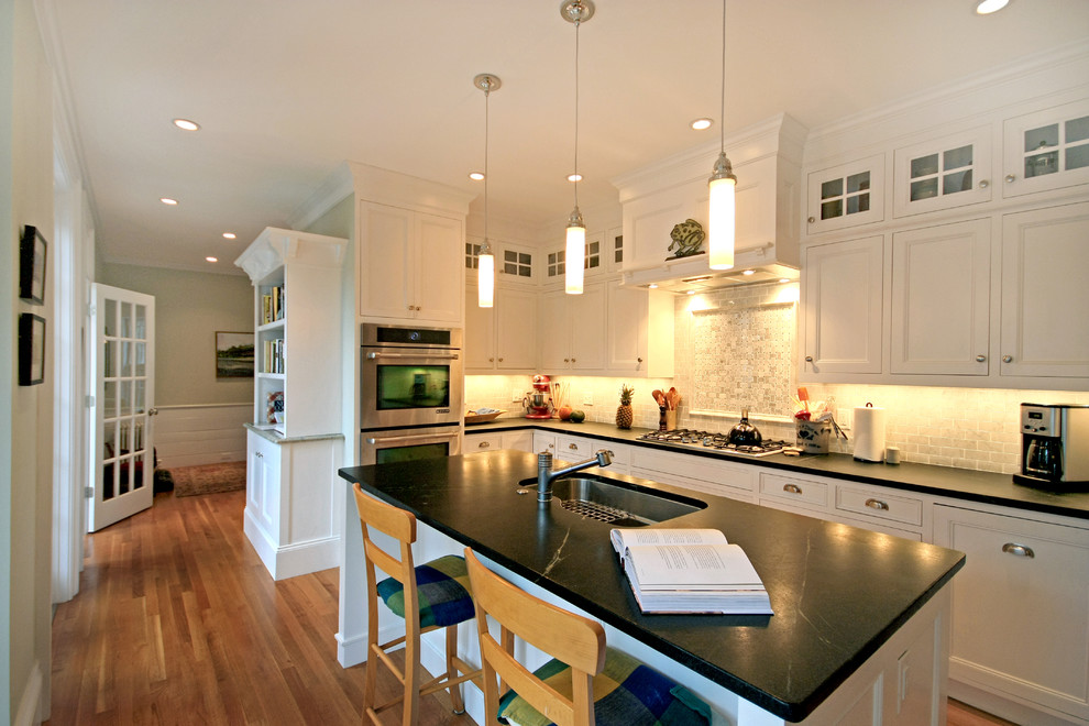 Kitchen - traditional kitchen idea in Boston with recessed-panel cabinets