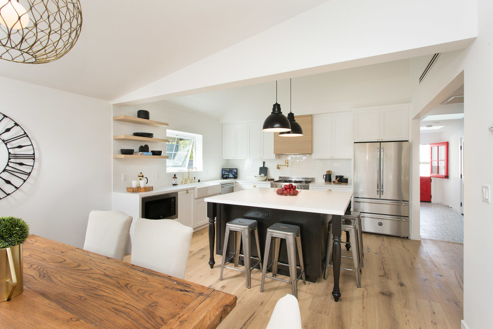 Kitchen - cottage kitchen idea in Los Angeles with a farmhouse sink, shaker cabinets, white cabinets and quartzite countertops