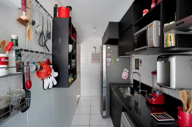 Small trendy kitchen photo in Other with black cabinets