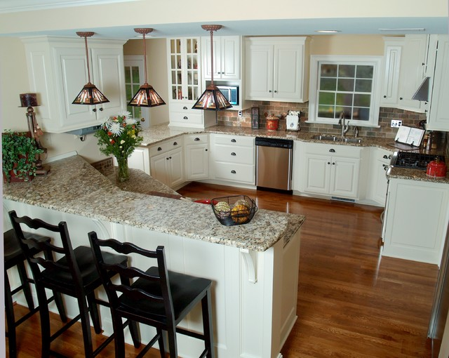 Example Of A Large Classic U Shaped Medium Tone Wood Floor Eat In Kitchen