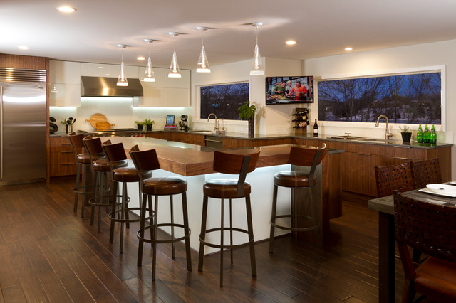 Inspiration for a large contemporary l-shaped dark wood floor eat-in kitchen remodel in Minneapolis with an undermount sink, flat-panel cabinets, medium tone wood cabinets, granite countertops, white backsplash, glass sheet backsplash, stainless steel appliances and an island