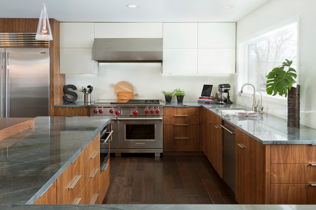 Example of a large trendy l-shaped dark wood floor eat-in kitchen design in Minneapolis with an undermount sink, flat-panel cabinets, medium tone wood cabinets, granite countertops, white backsplash, glass sheet backsplash, stainless steel appliances and an island