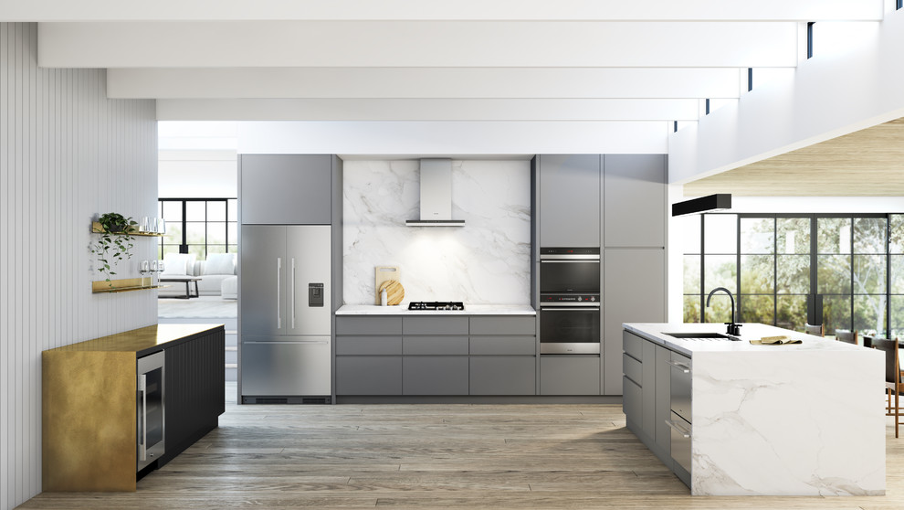 Example of a large trendy light wood floor open concept kitchen design in Buckinghamshire with a drop-in sink, flat-panel cabinets, gray cabinets, marble countertops, marble backsplash, stainless steel appliances and an island