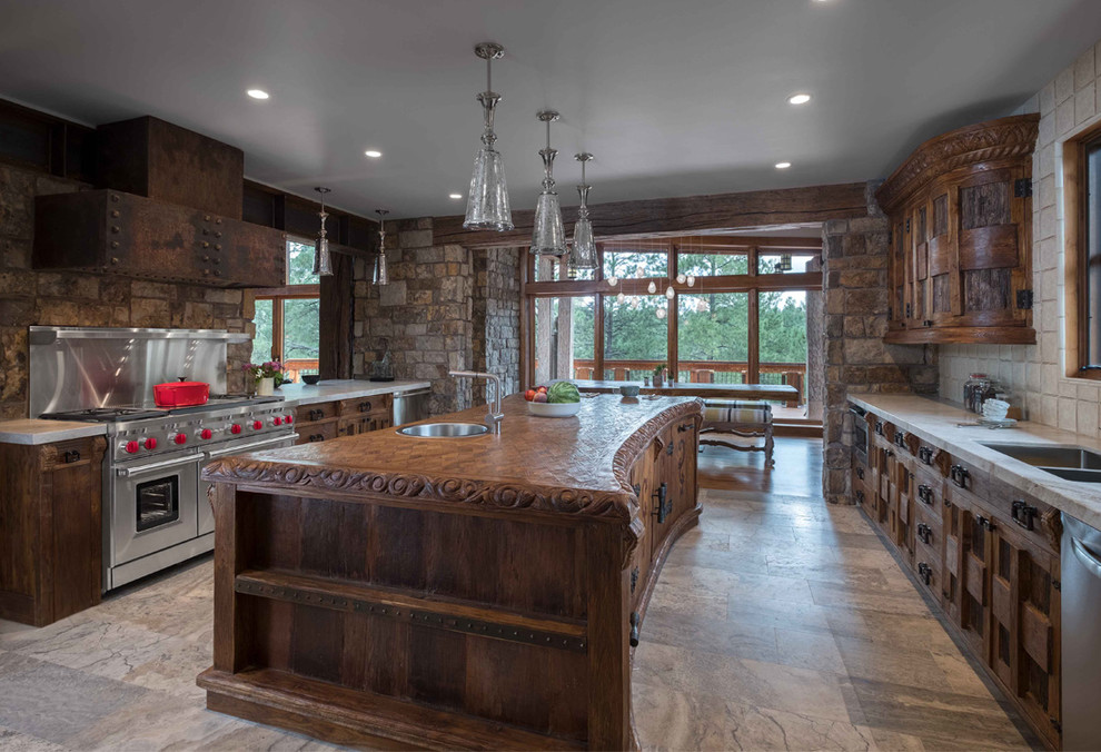 Example of a large mountain style galley ceramic tile eat-in kitchen design in Phoenix with a double-bowl sink, medium tone wood cabinets, stainless steel appliances, an island, recessed-panel cabinets, wood countertops, multicolored backsplash and stone tile backsplash