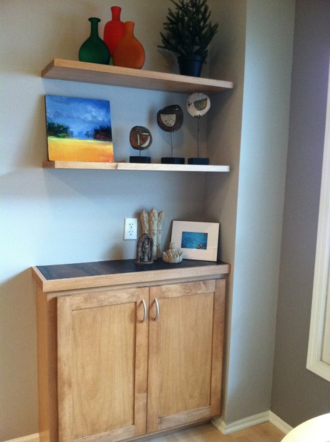 Floating shelves above this bar area are clean and for Traditional kitchen shelves