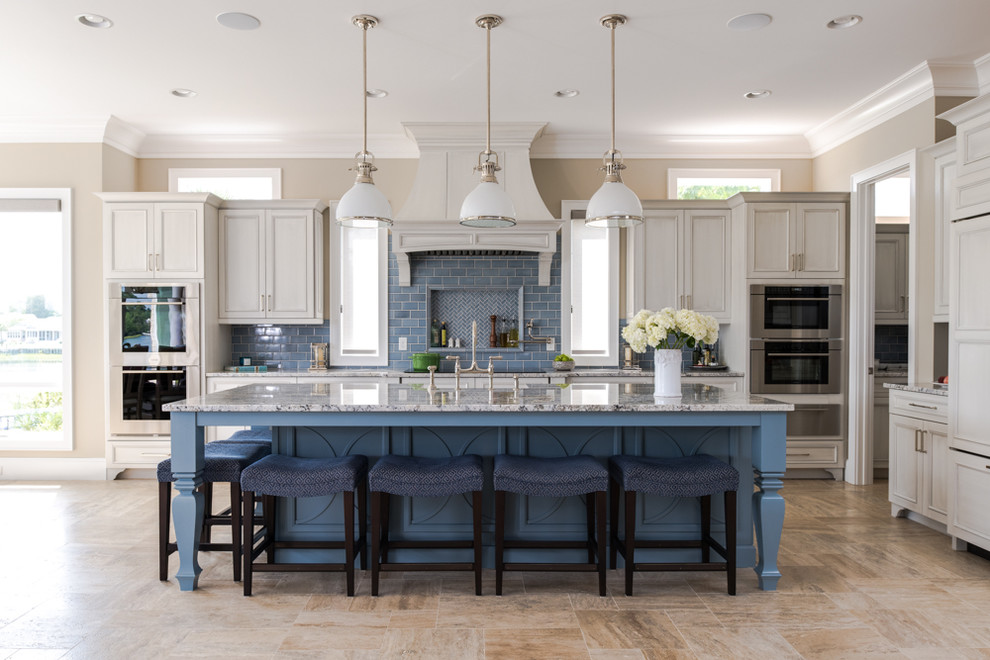 Inspiration for a coastal l-shaped beige floor kitchen remodel in Other with shaker cabinets, blue cabinets, blue backsplash, subway tile backsplash and an island