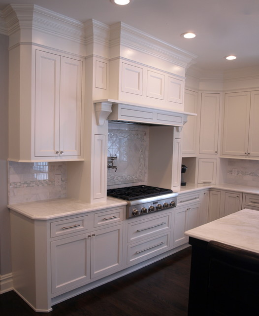 Flush inset cabinetry creates clean and simple lines with a girly touch traditional-kitchen