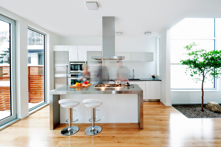 Kitchen - contemporary kitchen idea in Toronto with stainless steel countertops