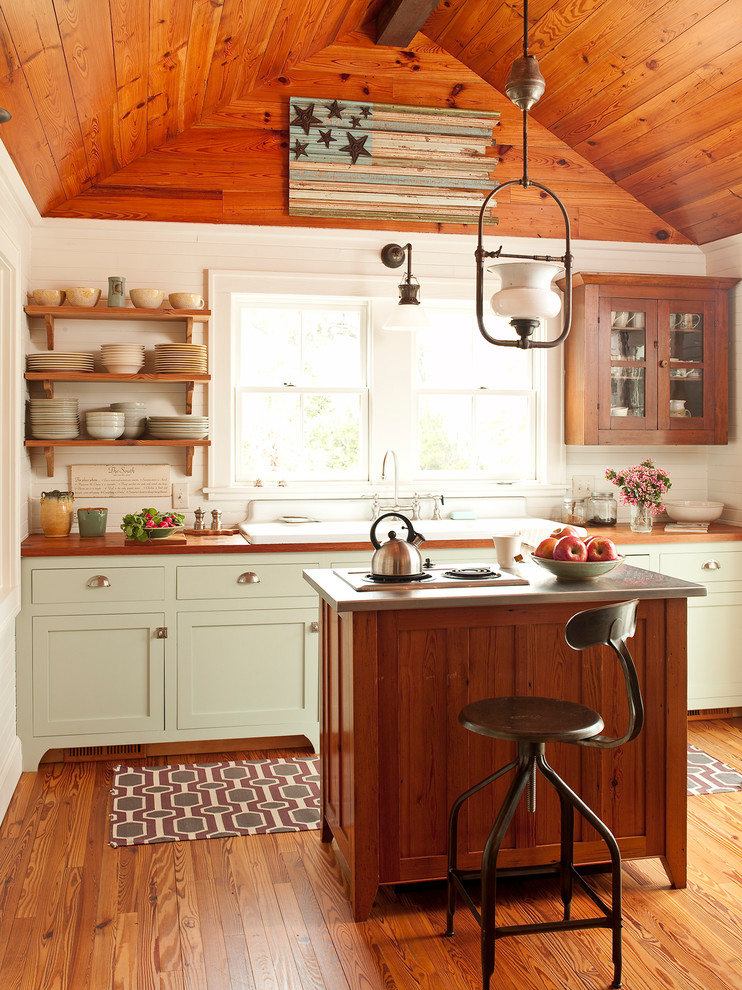 Example of a classic kitchen design in Atlanta with wood countertops, a drop-in sink, shaker cabinets and green cabinets