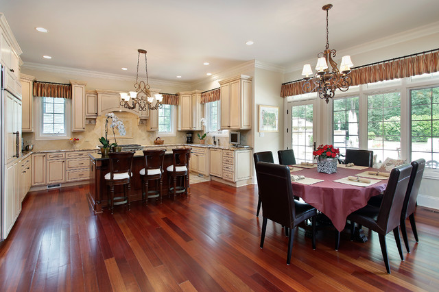 Elegant u-shaped dark wood floor kitchen photo in Denver with raised-panel cabinets, granite countertops, stone tile backsplash and an island