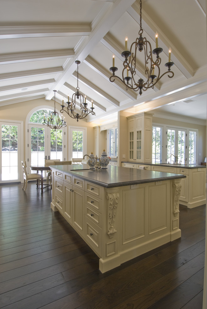 Eat-in kitchen - traditional eat-in kitchen idea in San Francisco with recessed-panel cabinets and beige cabinets