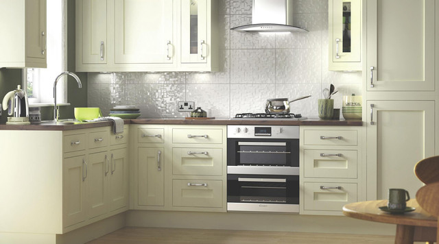 Example of a trendy kitchen design in Hampshire with flat-panel cabinets, white cabinets and wood countertops