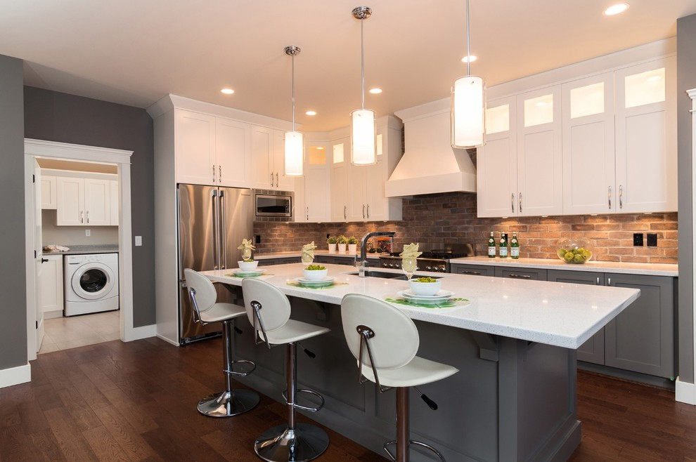 Kitchen - contemporary kitchen idea in Vancouver with stainless steel appliances and gray cabinets