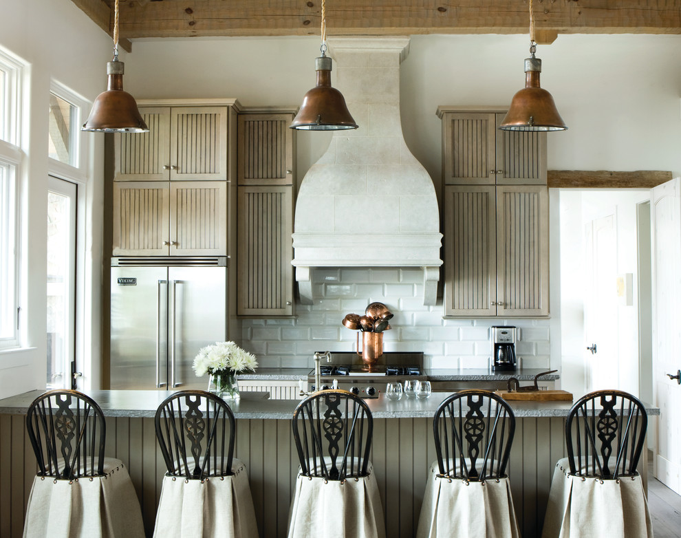 Example of a small farmhouse galley kitchen design in Atlanta with light wood cabinets, white backsplash, subway tile backsplash, stainless steel appliances, a peninsula, louvered cabinets and granite countertops