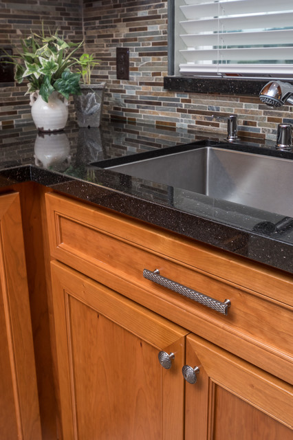 Kitchen With Cherry Cabinets Slate Tile And Black Galaxy Granite