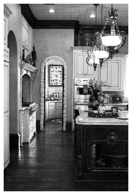 Photo of a large classic galley kitchen/diner in Dallas with an island.