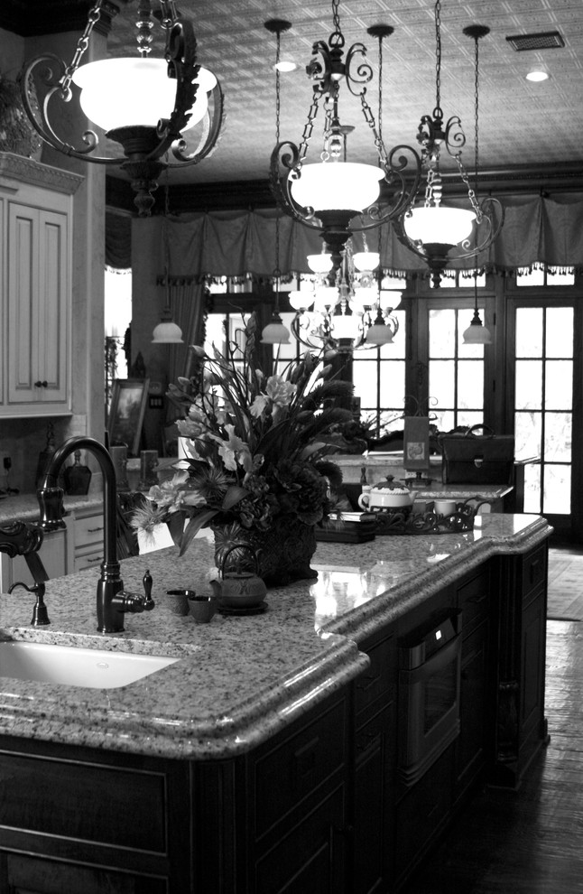 Eat-in kitchen - large traditional galley eat-in kitchen idea in Dallas with a drop-in sink and an island