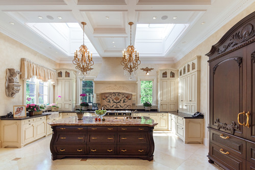 French Chateau Kitchen with antique island, Skylights, Wood Millwork Refrigerato