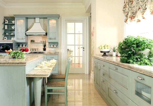Example Of A Tuscan U Shaped Eat In Kitchen Design In Other With Recessed