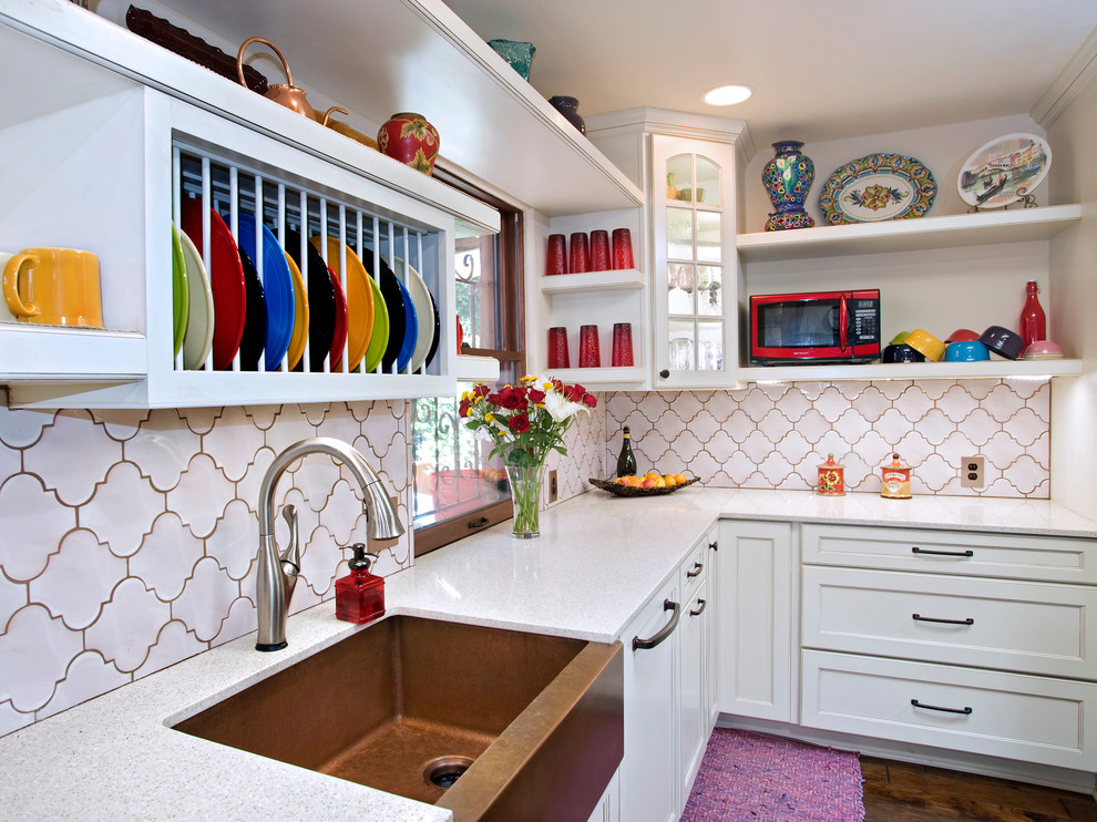 Example of an eclectic kitchen design in Austin with white backsplash, white cabinets, a farmhouse sink and recessed-panel cabinets