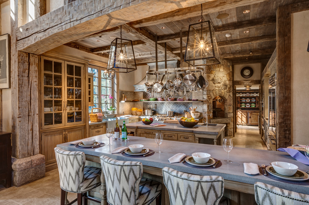 Inspiration for a timeless limestone floor kitchen remodel in New York with glass-front cabinets, medium tone wood cabinets, an island, a farmhouse sink, concrete countertops, beige backsplash, ceramic backsplash and stainless steel appliances