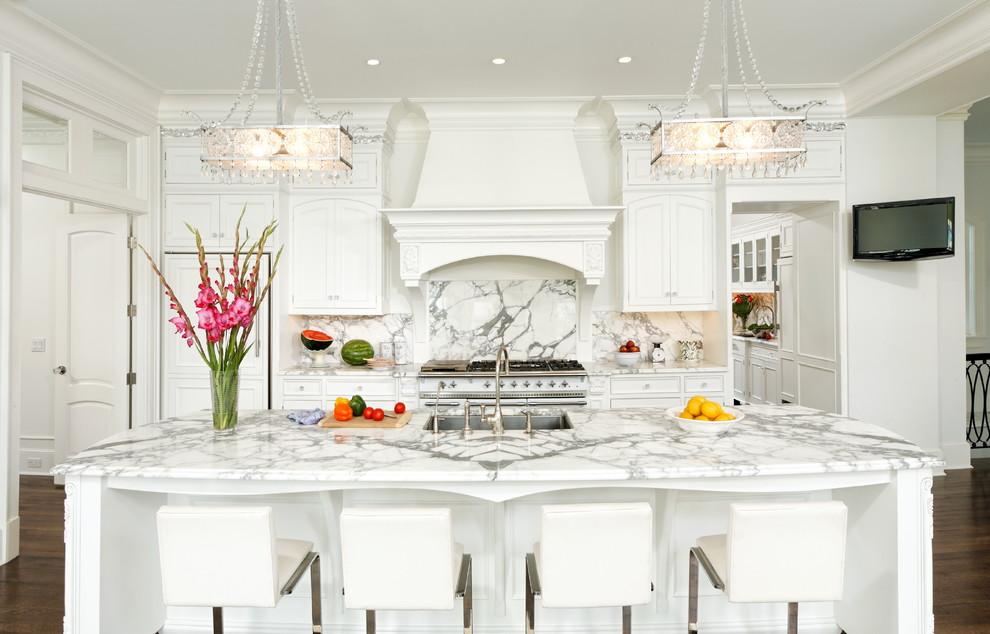Elegant galley kitchen photo in DC Metro with marble countertops, a single-bowl sink, beaded inset cabinets, white cabinets, white backsplash, stone slab backsplash and paneled appliances