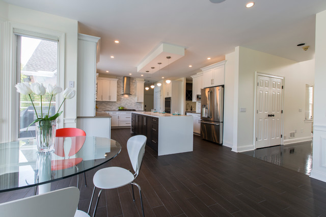 Open concept kitchen - huge contemporary l-shaped porcelain floor open concept kitchen idea in Bridgeport with an undermount sink, shaker cabinets, white cabinets, quartz countertops, white backsplash, mosaic tile backsplash, stainless steel appliances and an island