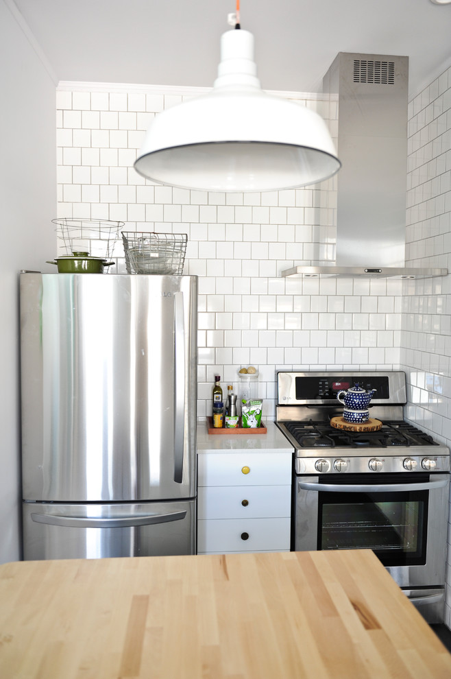 Example of an eclectic kitchen design in Vancouver with stainless steel appliances