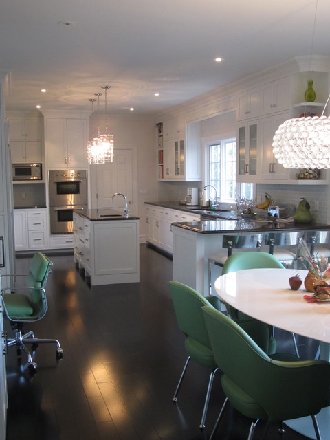 Example of a trendy kitchen design in New York with shaker cabinets and stainless steel appliances