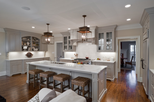 Inspiration for a timeless u-shaped open concept kitchen remodel in Charlotte with recessed-panel cabinets, gray cabinets, white backsplash, paneled appliances and white countertops