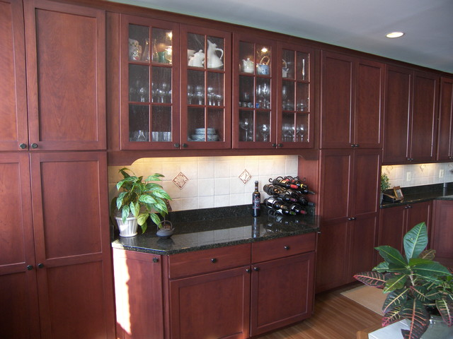 Full size kitchen remodel with black granite and walnut for Black walnut kitchen cabinets