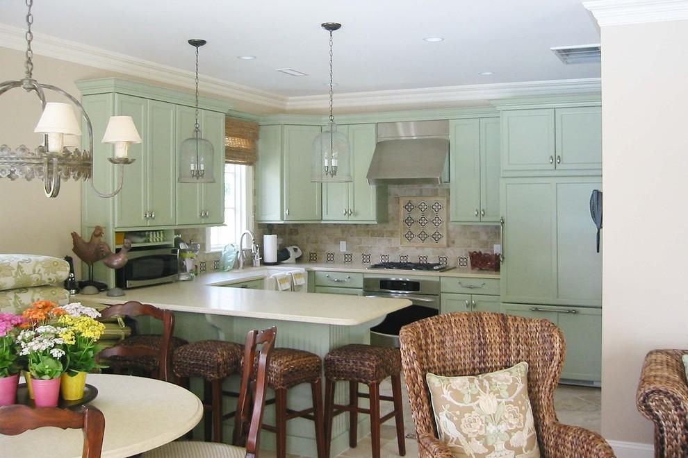 Elegant u-shaped kitchen photo in Boston with shaker cabinets, green cabinets, multicolored backsplash and paneled appliances