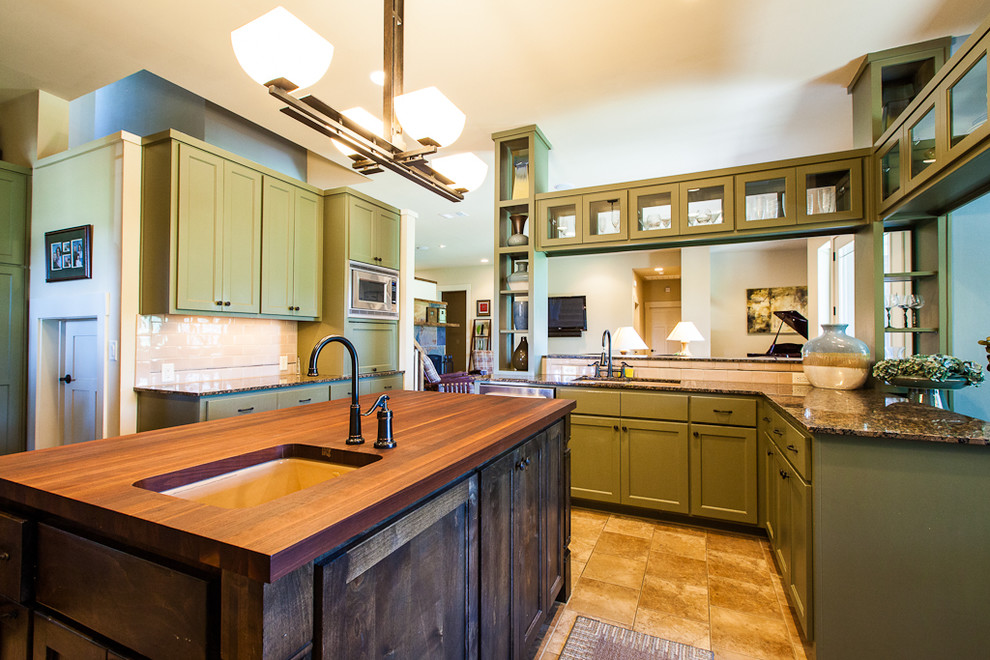 Example of a trendy kitchen design in Austin with granite countertops and green cabinets