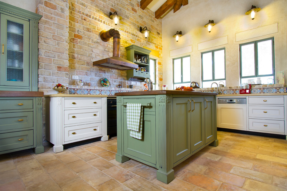 Elegant kitchen photo in Other with recessed-panel cabinets, green cabinets and multicolored backsplash