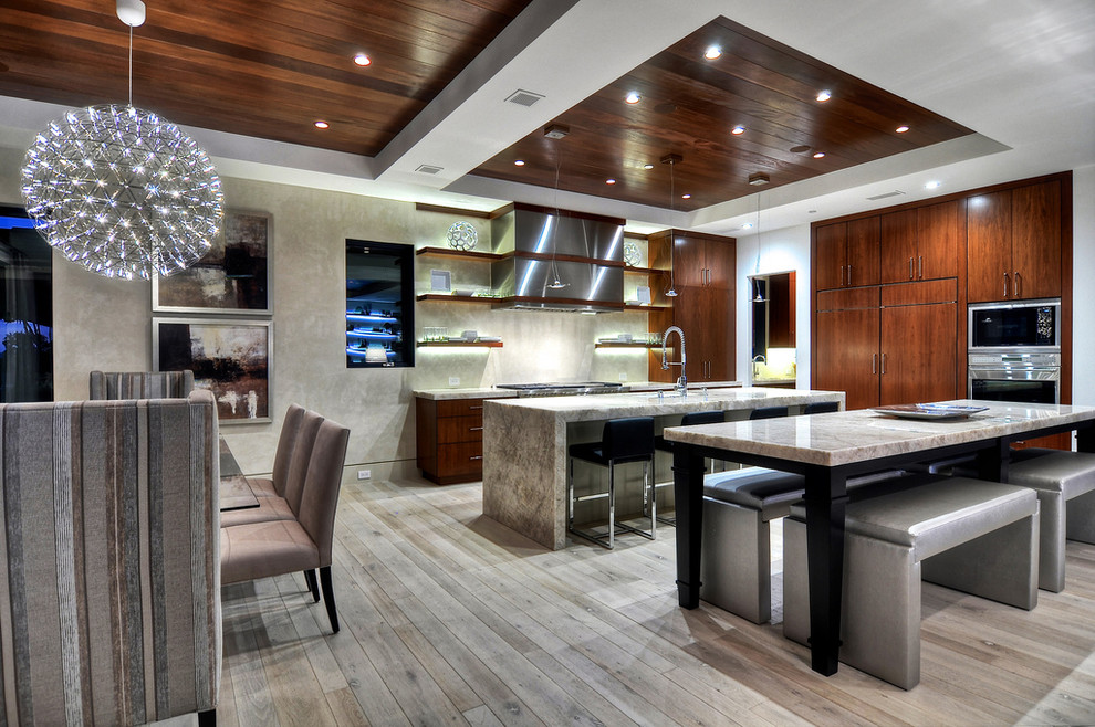 Eat-in kitchen - contemporary laminate floor eat-in kitchen idea in Orange County with flat-panel cabinets, dark wood cabinets and paneled appliances