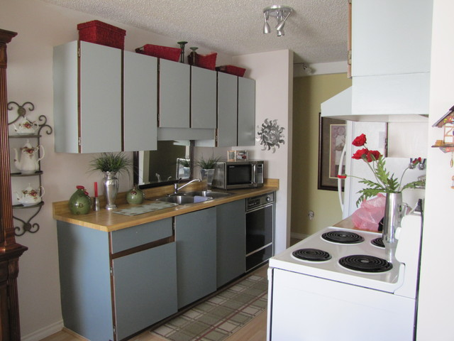 Galley kitchen before low budget modern kitchen for Small galley kitchen makeovers budget