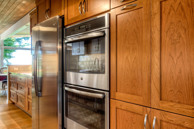 Galley kitchen featuring stainless steel appliances for Galley kitchen cabinets for sale