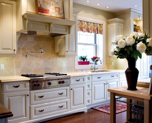 galley kitchen with movable butcher block