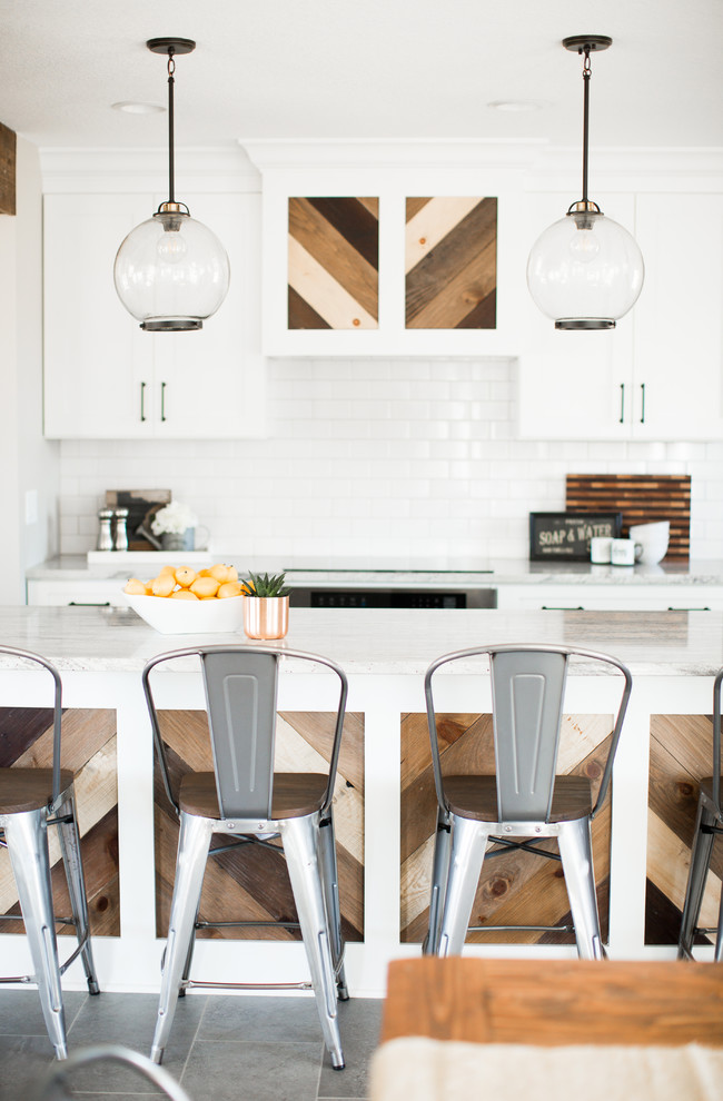 Eat-in kitchen - mid-sized cottage ceramic tile and gray floor eat-in kitchen idea in Minneapolis with a farmhouse sink, shaker cabinets, white cabinets, granite countertops, white backsplash, ceramic backsplash, stainless steel appliances and an island