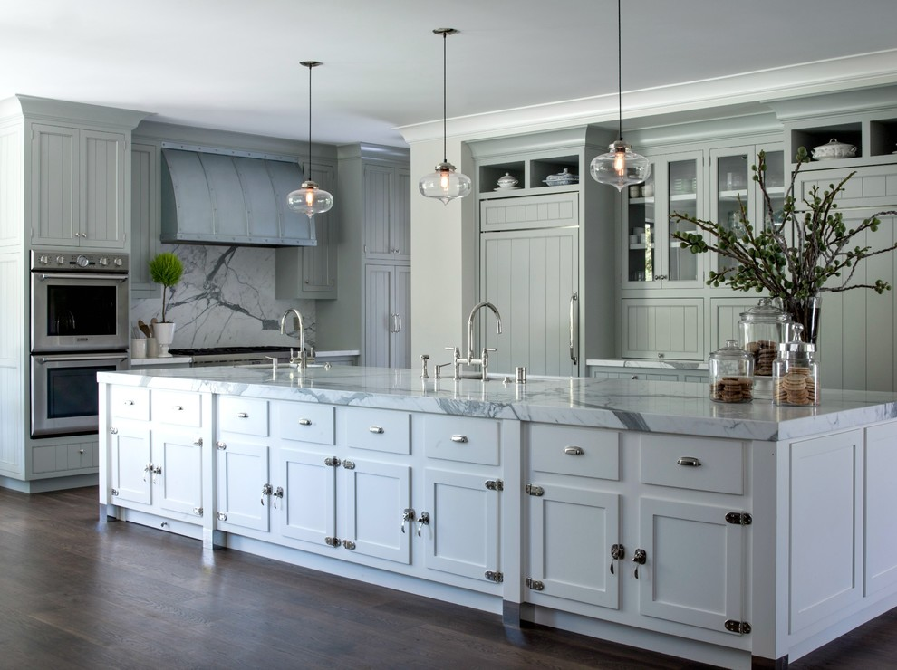 Example of a large farmhouse galley medium tone wood floor eat-in kitchen design in San Francisco with an undermount sink, shaker cabinets, blue cabinets, marble countertops, white backsplash, stone slab backsplash, stainless steel appliances and an island