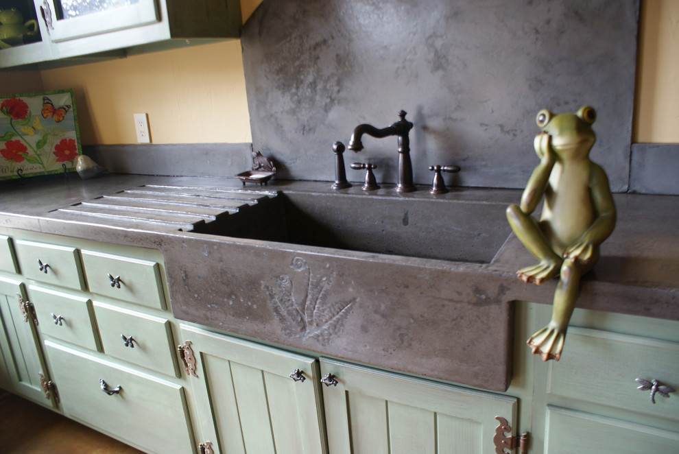 Kitchen - eclectic kitchen idea in Charlotte with an integrated sink, green cabinets and concrete countertops