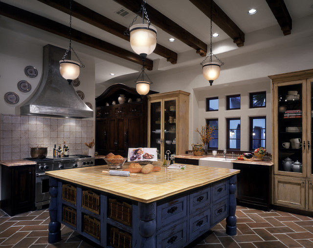Inspiration for a huge eclectic u-shaped terra-cotta floor eat-in kitchen remodel in Houston with a farmhouse sink, beaded inset cabinets, distressed cabinets, tile countertops, stainless steel appliances and an island