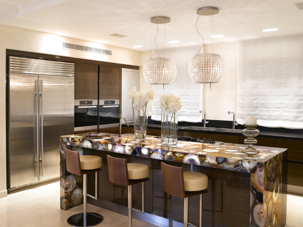 Trendy kitchen photo in Dallas with stainless steel appliances and multicolored countertops