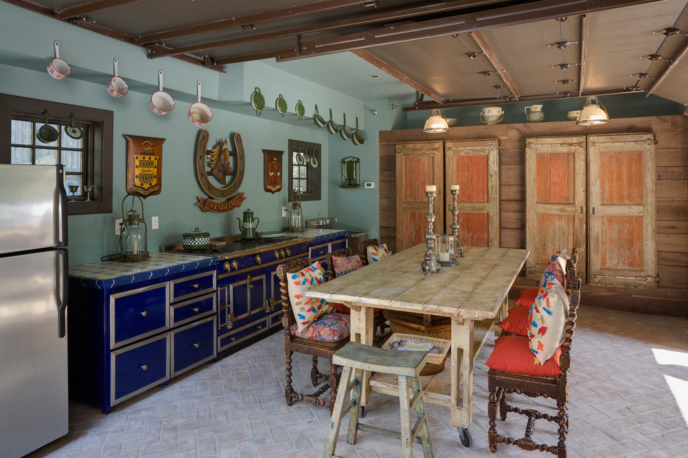 Eat-in kitchen - eclectic brick floor eat-in kitchen idea in DC Metro with blue cabinets and colored appliances