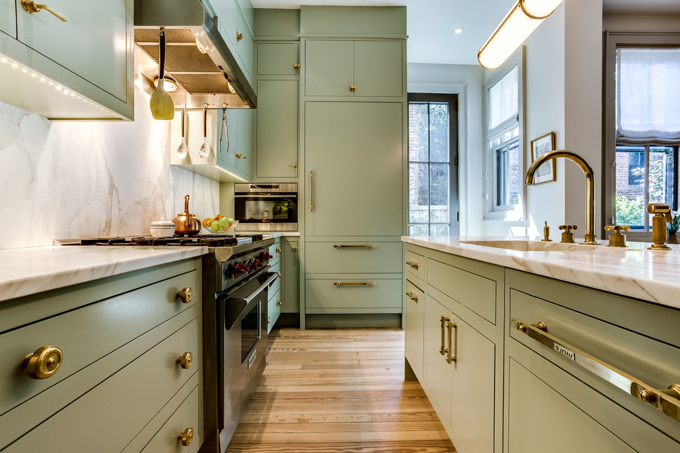 Kitchen - mid-sized transitional l-shaped light wood floor and brown floor kitchen idea in DC Metro with an integrated sink, flat-panel cabinets, green cabinets, quartzite countertops, stainless steel appliances and an island