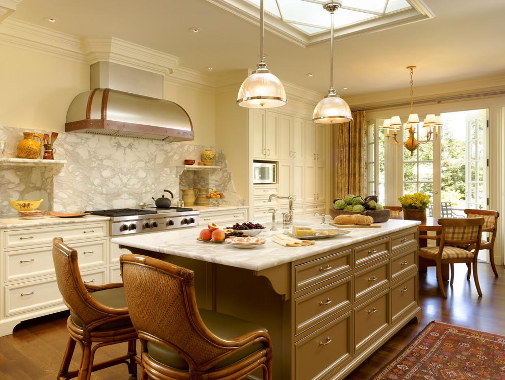 Elegant eat-in kitchen photo in San Francisco with recessed-panel cabinets, beige cabinets, white backsplash and marble backsplash