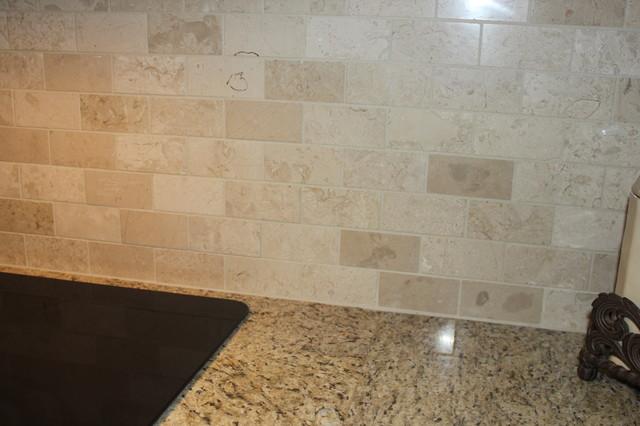 Giallo Ornamental Granite CountertopCrema Marfil Backsplash