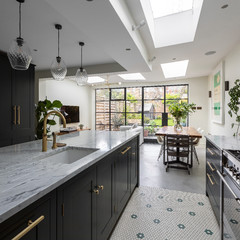 Kitchen Tour: A Dark Green Painted Kitchen With a Gorgeous Pantry