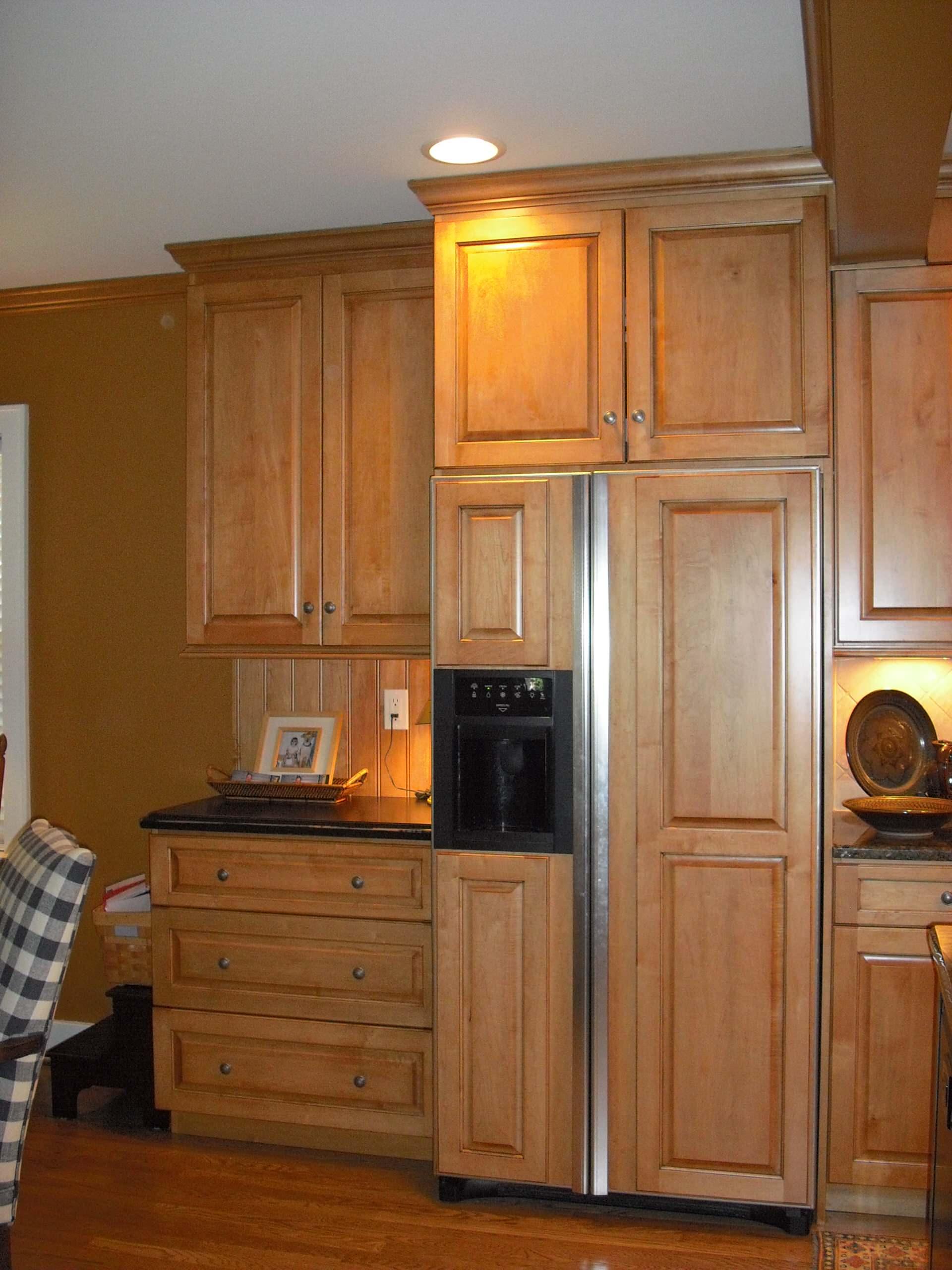 Ginger Maple Kitchen.  Refrigerator paneling.