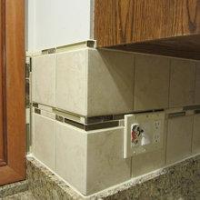 Glass and stone accent tile backsplash